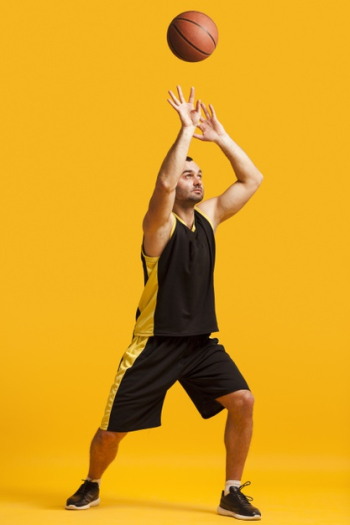 Front view of male basketball player dunking Free Photo