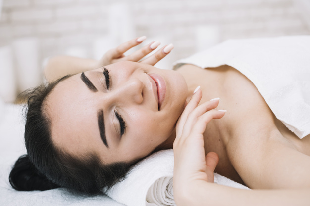 Woman Receiving A Relaxing Facial Massage Free Photo Nohat