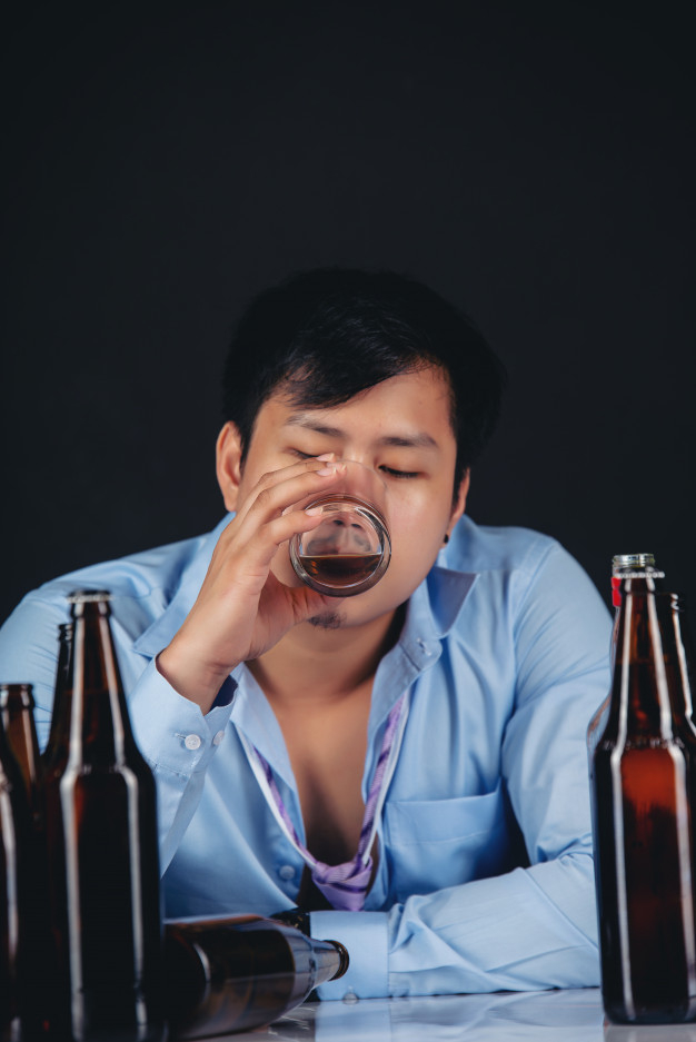 Alcoholic asian man drinking whisky with a lot of bottles Free Photo -  Nohat - Free for designer