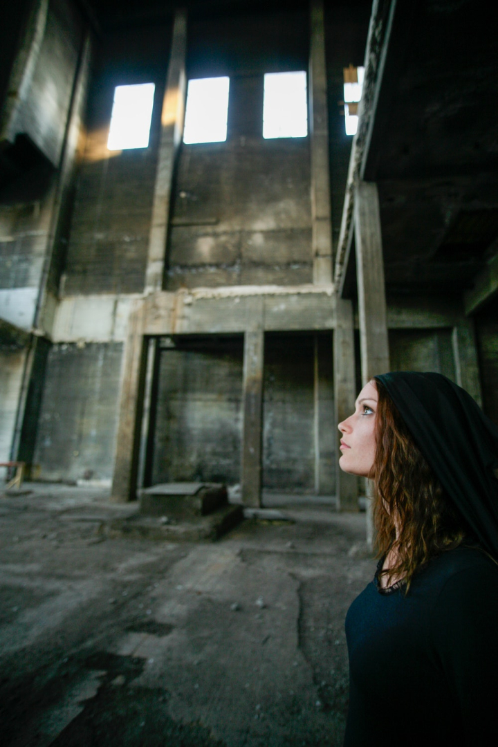 Side View Photo Of Woman In Black Dress Looking Up While Standing In Abandoned Building Nohat Free For Designer