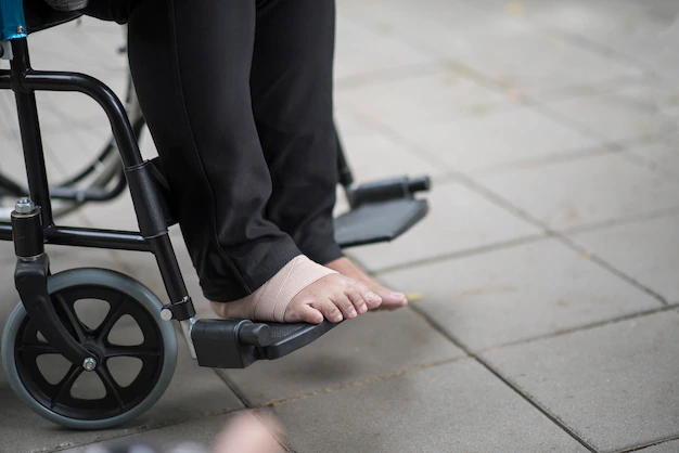 Close up elderly feet pain sitting on wheelchair - Nohat