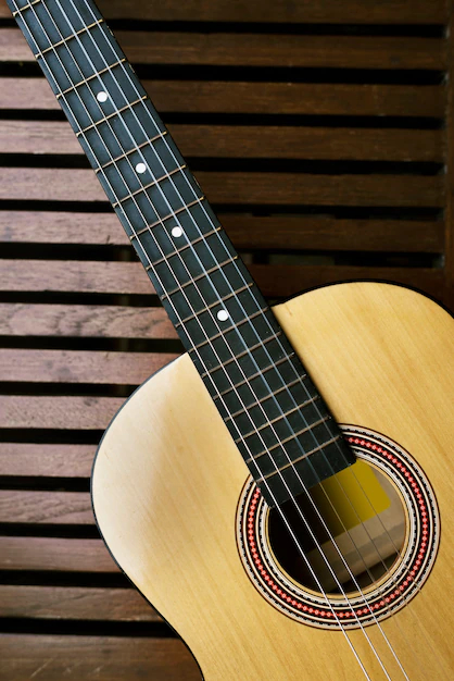 Acoustic guitar on a wooden floor - Nohat