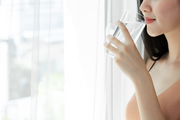 Close up beauty woman asian cute girl feel happy drinking clean drink water  for good health in the morning Free Photo - Nohat - Free for designer